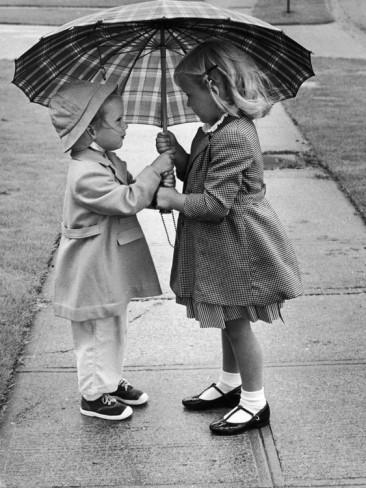 josef-scaylea-girls-sharing-an-umbrella